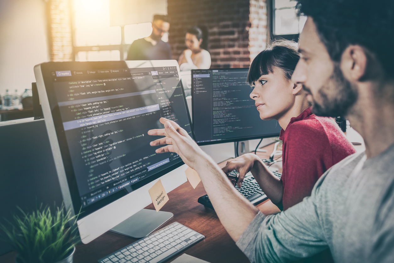 two people programming cybersecurity